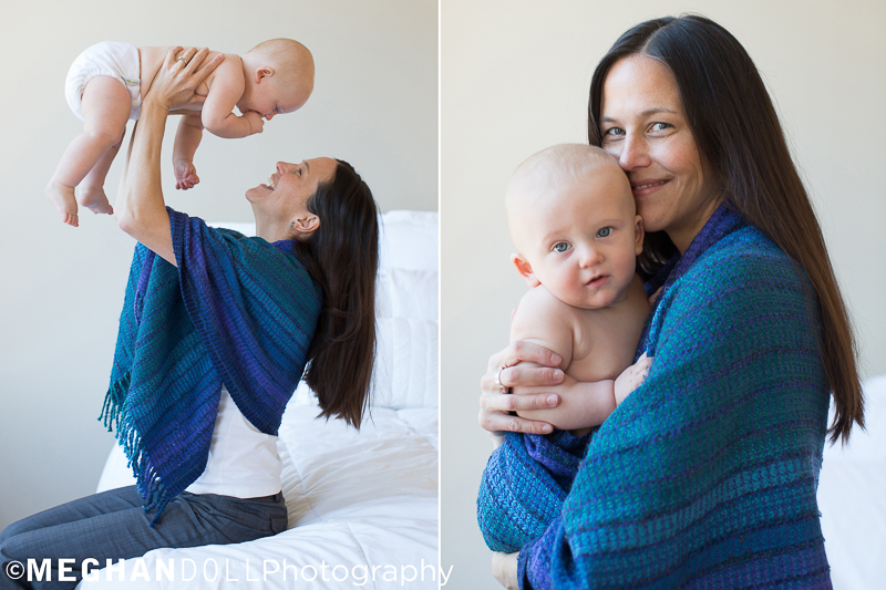 Beautiful mother shows off her darling baby boy wearing a blue scarf that matches his blue eyes