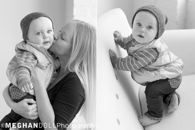 mom gives adorable baby boy a big smooch on the cheek while he smiles