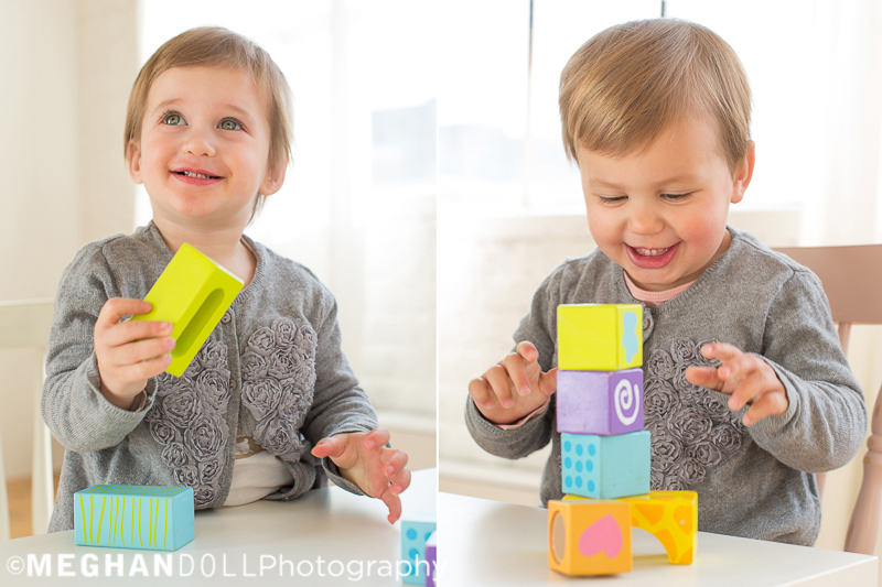 twin-girls-try-to-make-a-block-tower-on-little-white-table