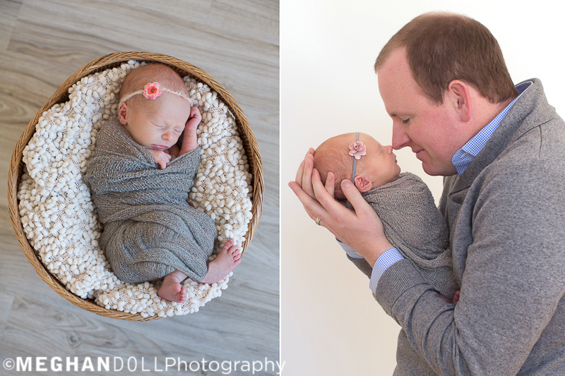 beautiful little newborn baby girl sleeps peacefully in round basket and dad touches noses with his new baby girl