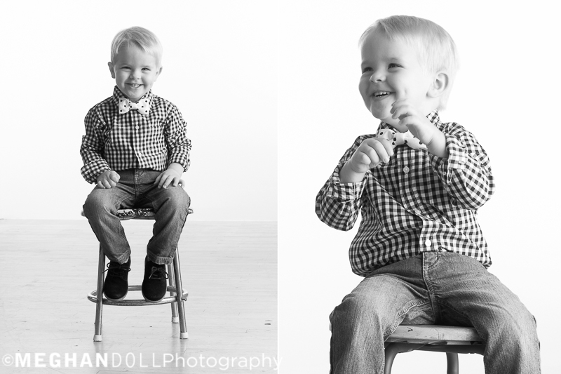 adorable two year old boy in plaid sits on stool and puts on a show