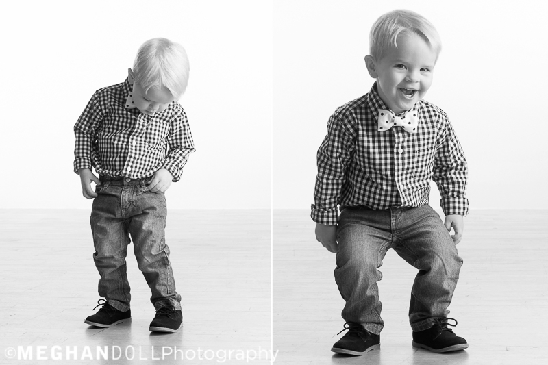 two year old boy looks for treasures in his pocket and makes funny faces