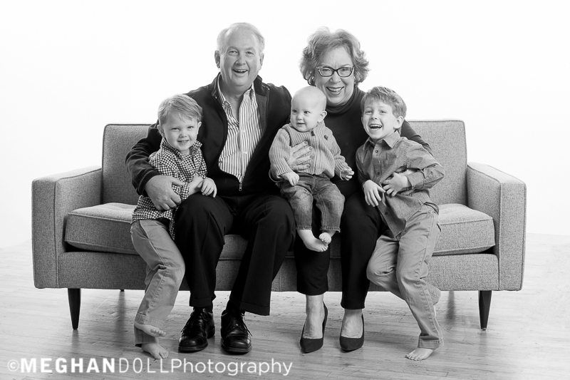 grandma and grandpa tickle their three little grandkids