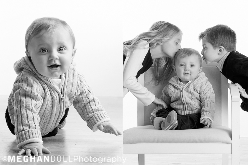 one year old baby boy gets kisses from his siblings