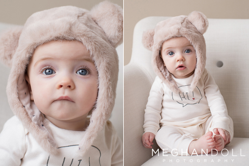 precious baby girl in bear hat stares at camera