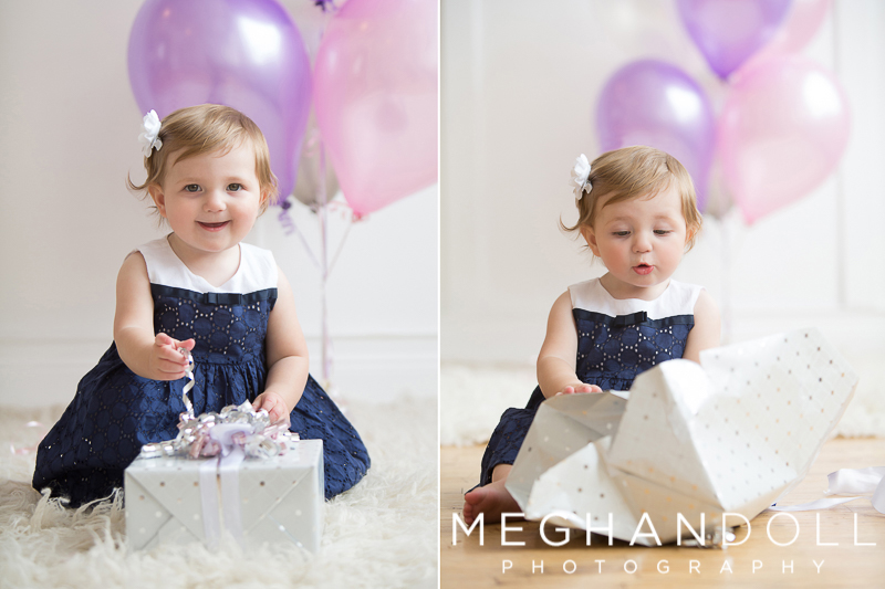 one year old baby girl opens her silver birthday present