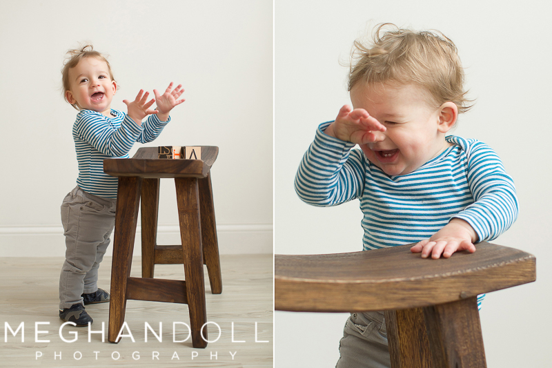 one-year-old-little-boy-laughs-and-plays-with-blocks-on-wooden-stool