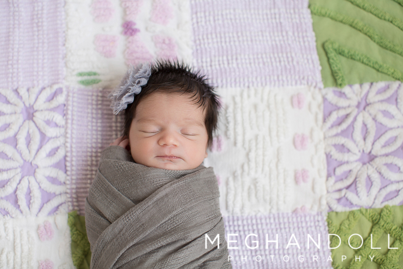 sweet-newborn-baby-girl-sleeps-on-special-quilt
