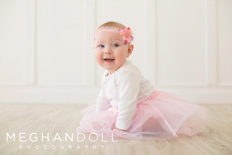 6-month-old-baby-girl-plays-with-her-tutu