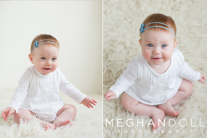 little-six-month-old-baby-girl-with-red-hair-wears-blue-headband