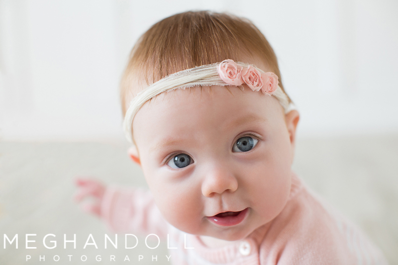 red-head-six-month-old-baby-in-pink-with-big-blue-eyes