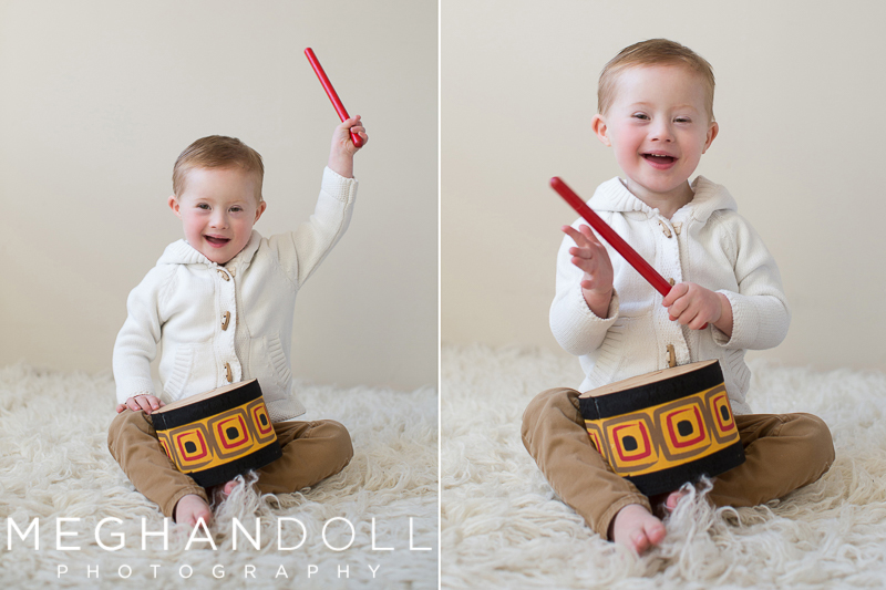 little-three-year-old-boy-in-white-sweater-plays-his-drum