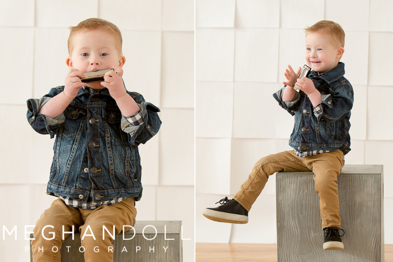 three-year-old-boy-in-jean-jacket-plays-his-harmonica