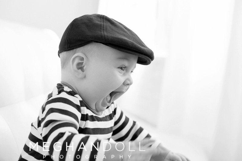 laughing-six-month-old-boy-with-hat-on