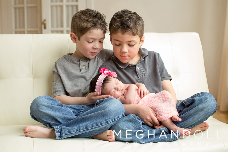 cute-big-brothers-hold-their-new-sister