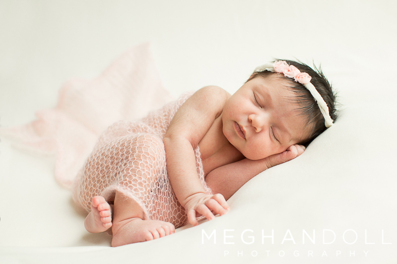 sweet-little-baby-girl-sleeps-in-pretty-pink-wrap
