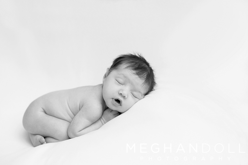 sweet-sleeping-newborn-baby-girl-on-white-milky-blanket
