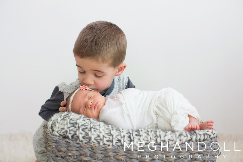 new-big-brother-gives-his-new-sister-a-little-kiss-while-she-sleeps