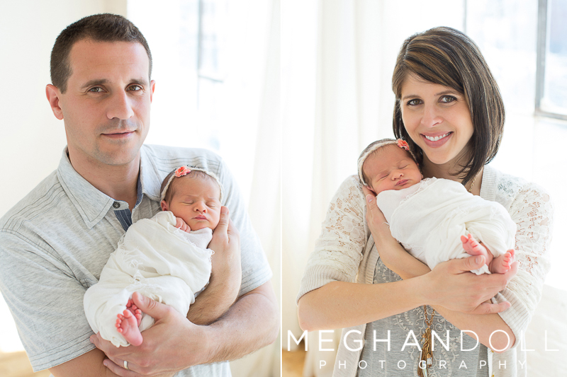 proud-mom-and-dad-show-off-their-new-baby-girl