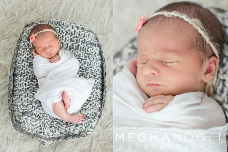 sweet-newborn-baby-girl-sleeps-in-gray-basket
