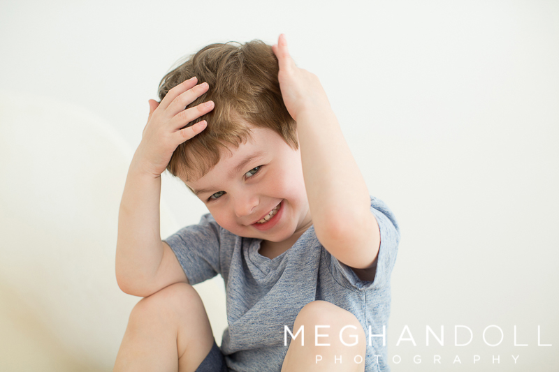 cute-little-boy-laughts-and-plays-with-his-hair
