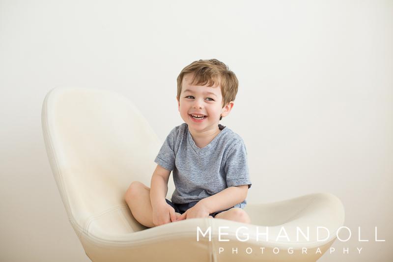sweet-little-boy-smiles-in-big-chair