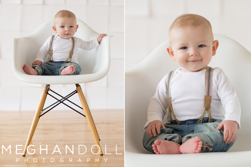 six-month-old-baby-boy-sits-in-chair-wearing-suspenders