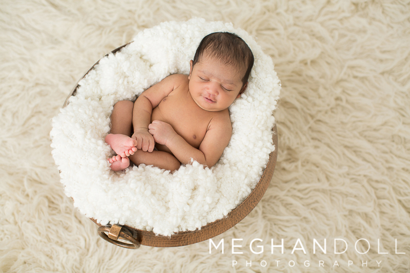 little-newborn-boy-sleeps-in-gorgeous-brass-bowl