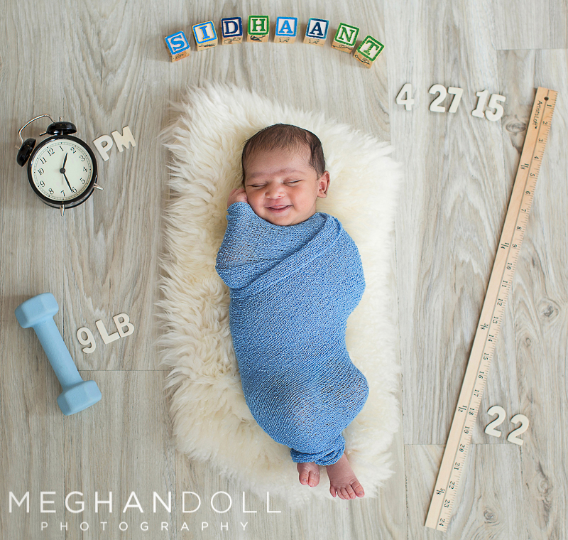 sweet-newborn-baby-with-all-of-his-birth-info