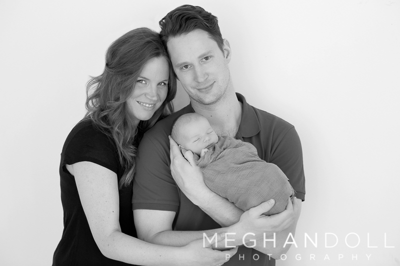 mom-and-dad-snuggle-with-their-first-little-baby-boy