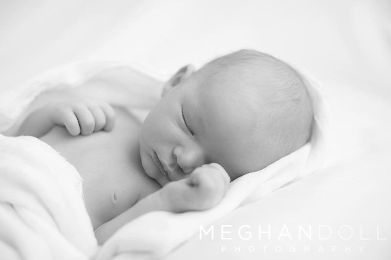 sleepy-little-newborn-boy-dreams-in-soft-white-blanket