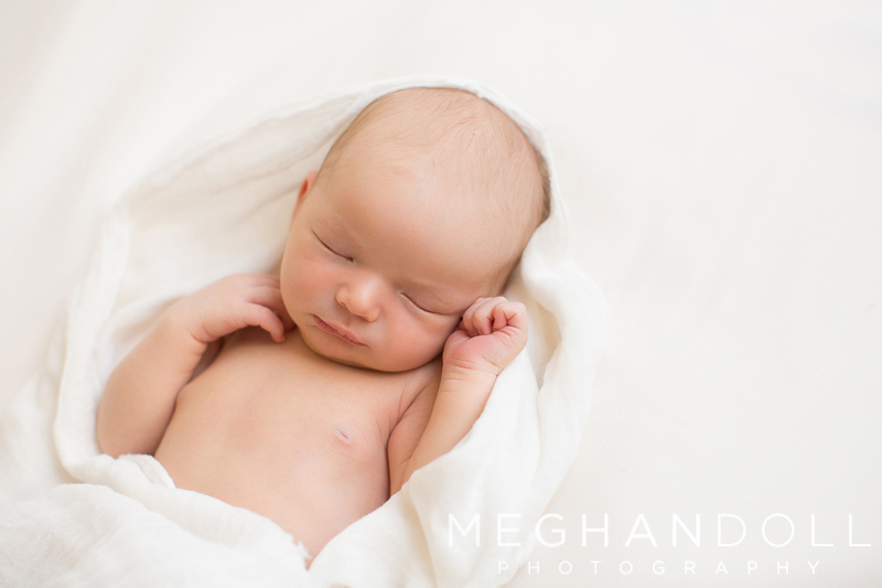 tiny-little-newborn-boy-sleeps-in-creamy-white-blanket