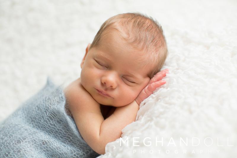 little-twin-brother-sleeps-sweetly-on-big-white-blanket