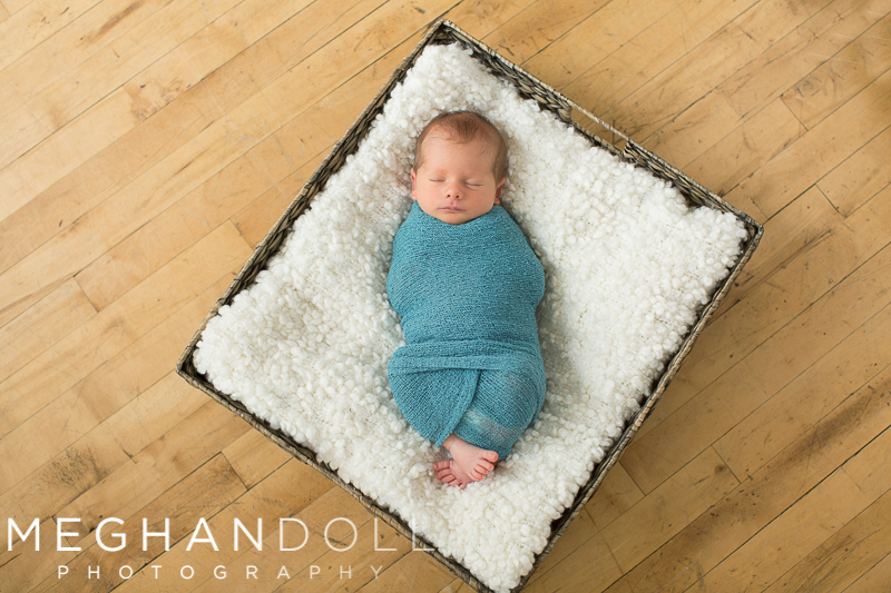 tiny-newborn-twin-boy-snuggles-in-square-basket