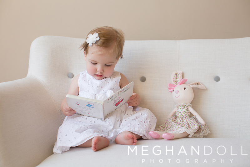 one-year-old-girl-reads-to-her-little-bunny-friend