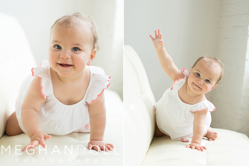 little-one-year-old-girl-in-white-crawls-on-big-white-couch
