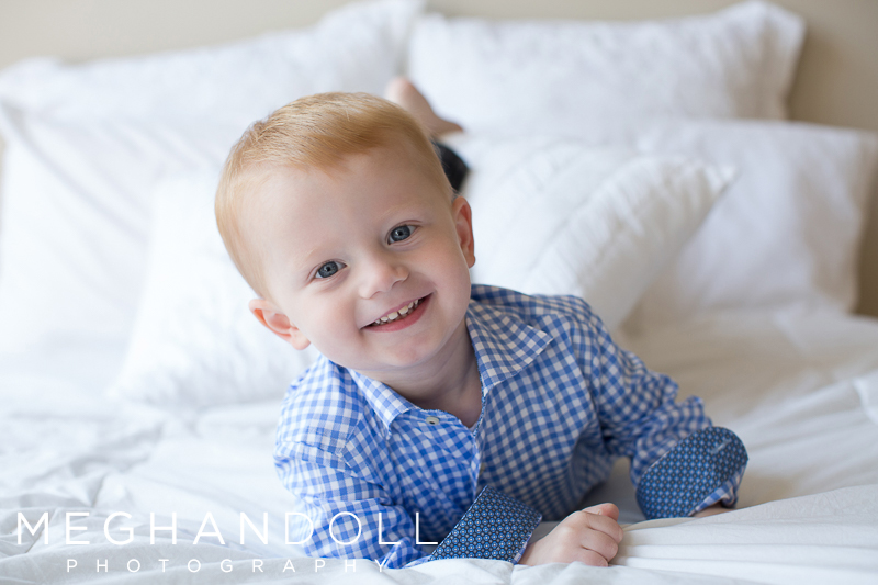 little-two-year-old-boy-rolls-around-on-big-white-bed