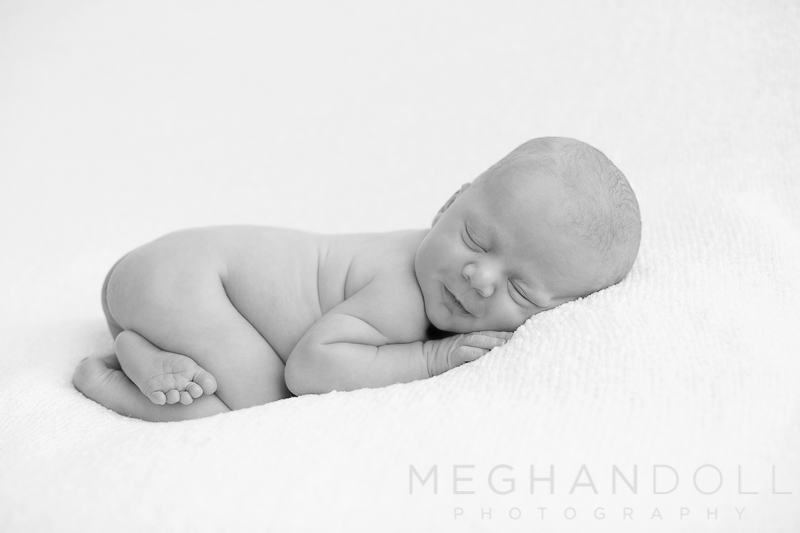 little-naked-newborn-boy-on-big-white-blanket