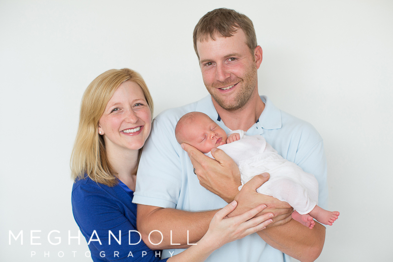 new-parents-smile-with-their-brand-new-son