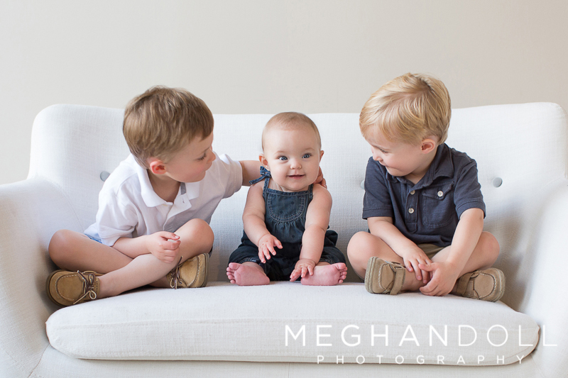 big-brothers-smile-at-their-baby-sister