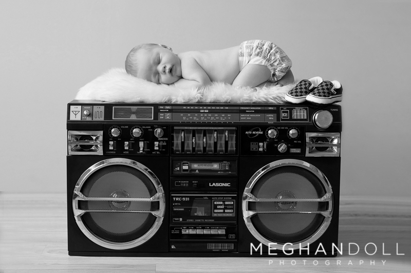 newborn-boy-sleeps-on-dads-boombox