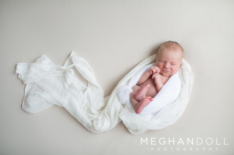 sweet-boy-in-white-sleeps-on-big-blanket