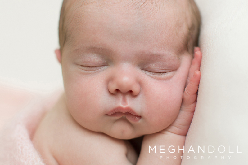 close-up-of-sweet-little-newborn-girls-face