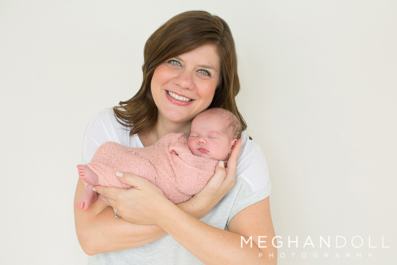 mom-smiles-while-holding-her-new-daughter