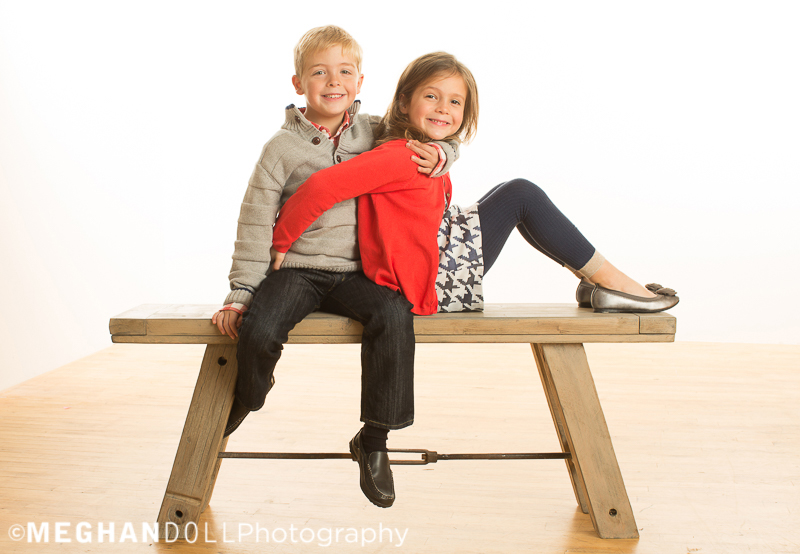 twin-siblings-play-on-big-bench