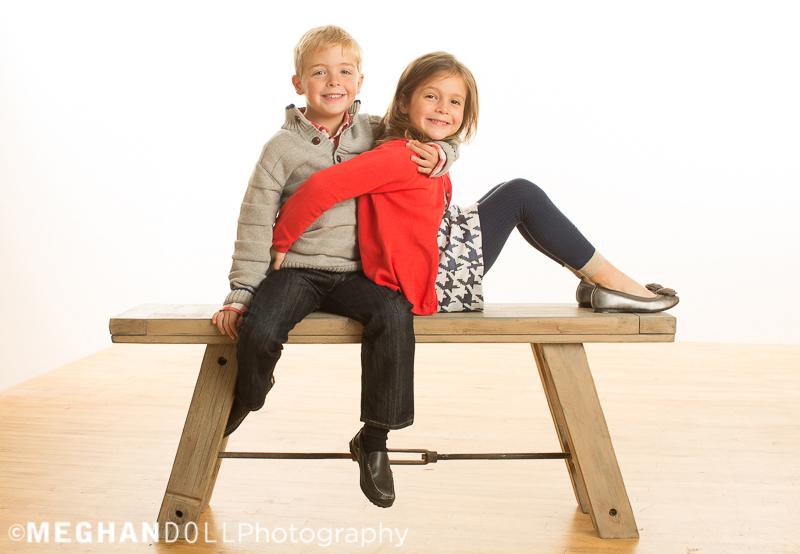 twin-siblings-play-on-big-bench
