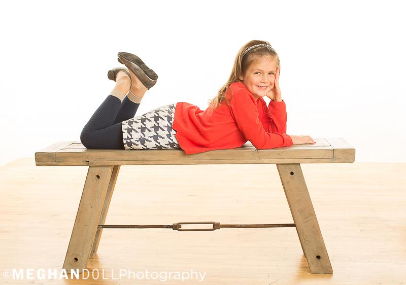 sweet-girl-smiles-on-big-bench