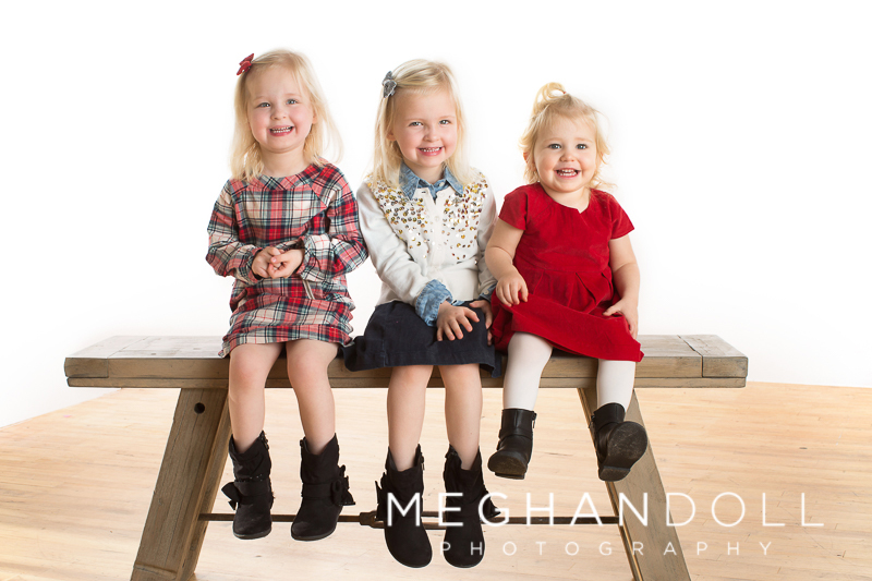 three-little-girls-sitting-on-a-bench