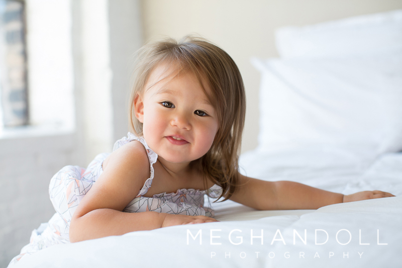 two-year-old-girl-slides-off-big-bed