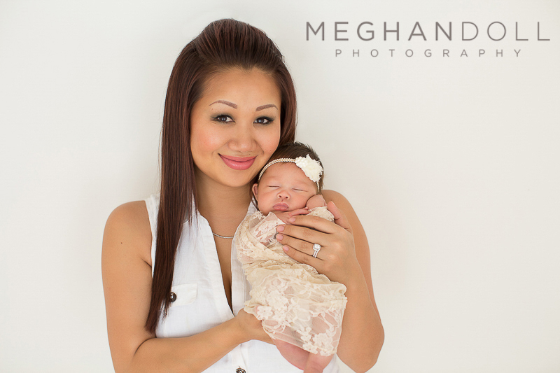 pretty-mom-holds-her-pretty-new-baby-girl